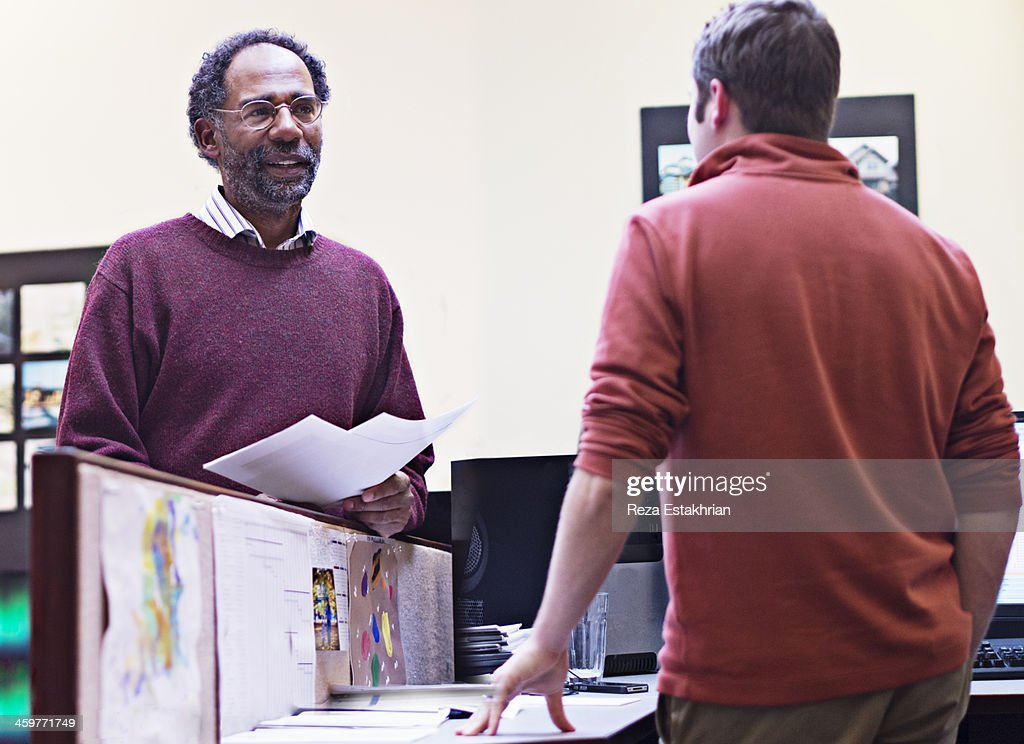 Chat over office partition : Stock Photo