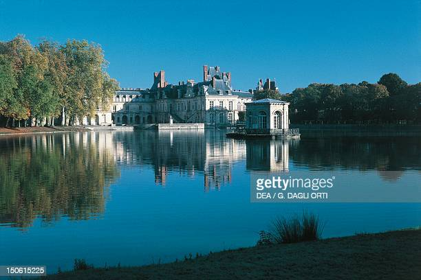 Chateau de Fontainebleau with carp pond France