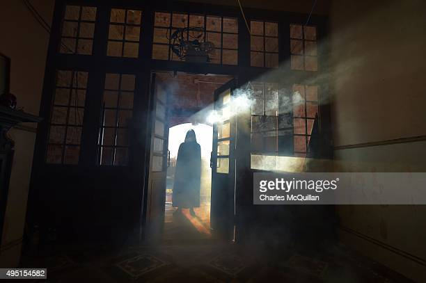 Chateau Le Fear cast member waits for thrill seekers at the house of horror show on October 31 2015 in Londonderry Northern Ireland Twenty actors in...