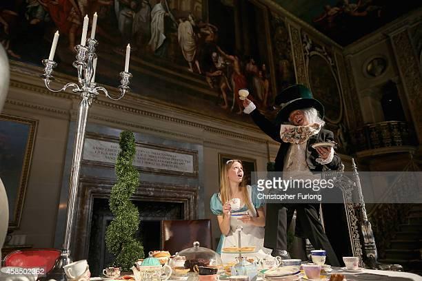 Chatsworth House staff members Ellie Cooper aged 19 and Tim Greaves pose as Alice in Wonderland and the Mad Hatter as they recreate the Mad Hatters...