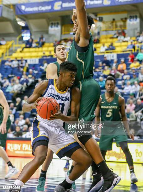 Chattanooga Mocs forward James Lewis Jr attempts to get to the basket during the first half of the college basketball game between UNC Charlotte and...