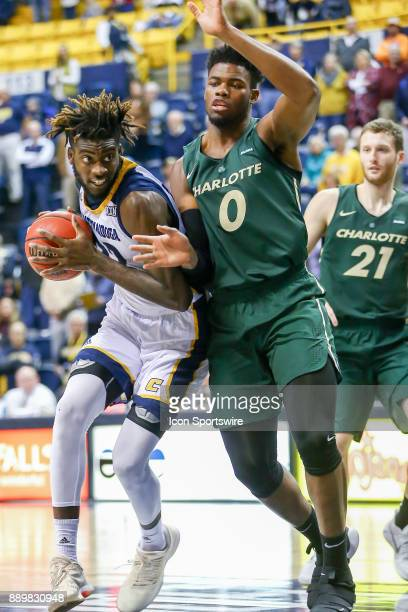 Chattanooga Mocs forward Makinde London drives to the basket during the college basketball game between UNC Charlotte and UTChattanooga on December...