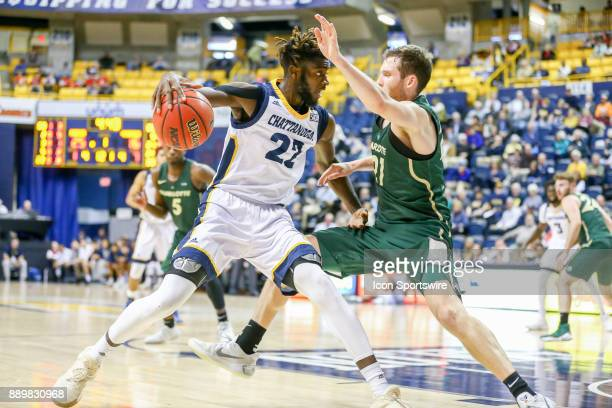 Chattanooga Mocs forward Makinde London drives to the basket during the first half of the college basketball game between UNC Charlotte and...