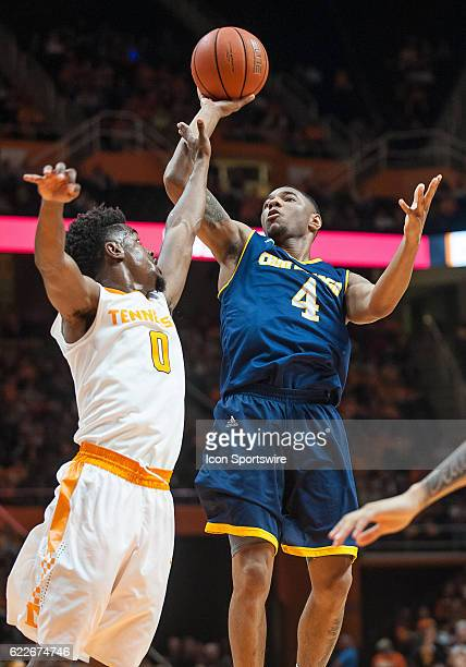 Chattanooga Mocs guard Johnathan BurroughsCook shoots over Tennessee Volunteers guard Jordan Bone during a game between the Chattanooga Mocs and...