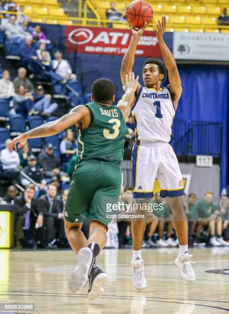 Chattanooga Mocs guard Rodney Chatman shoots a three point basket during the college basketball game between UNC Charlotte and UTChattanooga on...