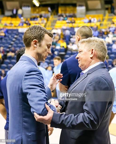 Chattanooga Mocs head coach Matt McCall and Citadel Bulldogs head coach Duggar Baucom greet each other before the NCAA basketball game between The...