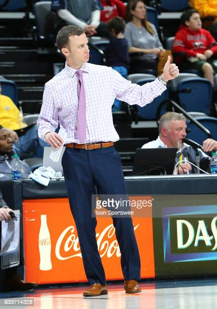 Chattanooga Mocs head coach Matt McCall reacts to a play with a thumbs up during the college basketball game between UT Chattanooga and UNC...