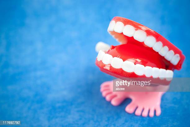 Chattering teeth with narrow dof on blue background