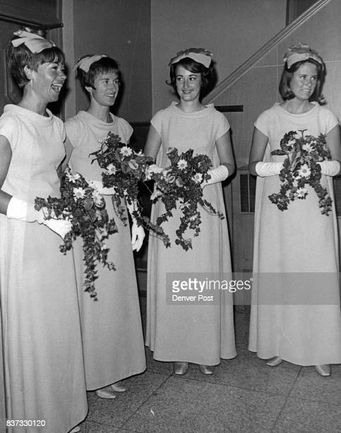 Chatting before the Friday wedding of Miss Virginia Anne Robinson to Edward Joseph Oswald are from left Mrs James L Frazier of Playa del Rey Calif...