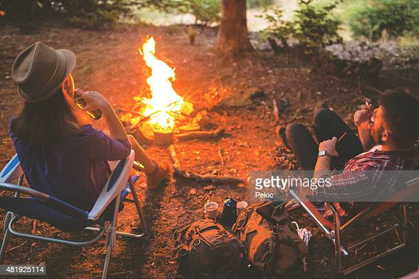 Chatting by campfire