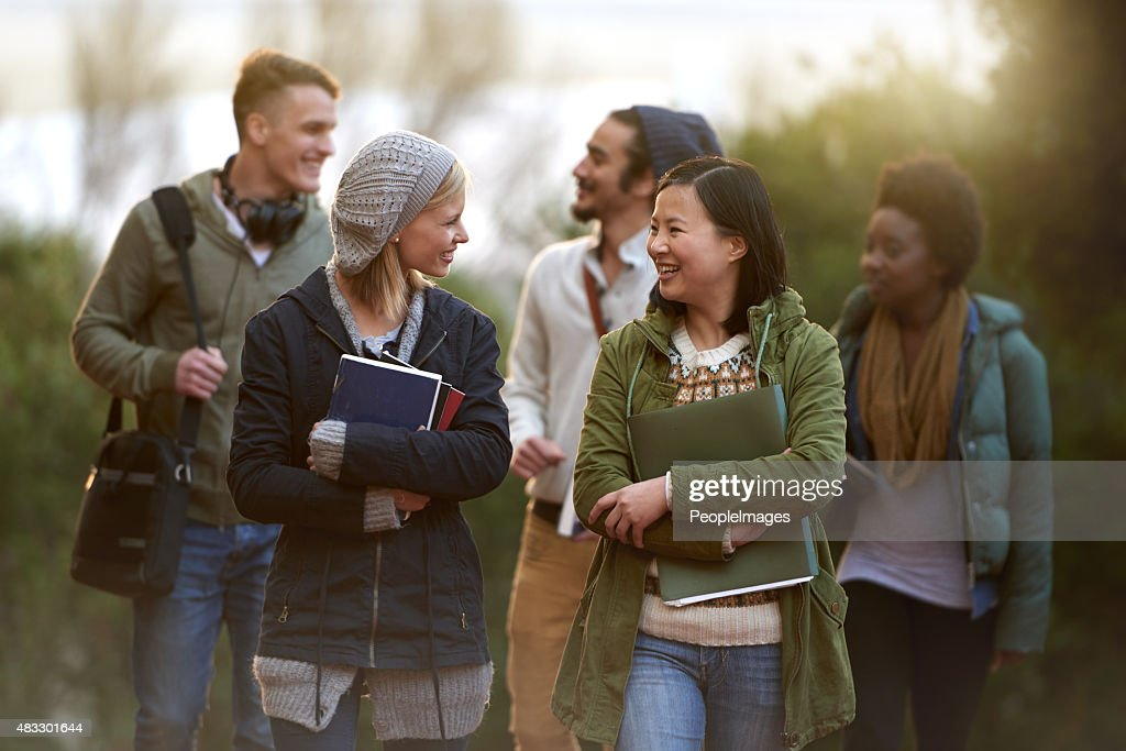 Chatting on the way to class : Stock Photo