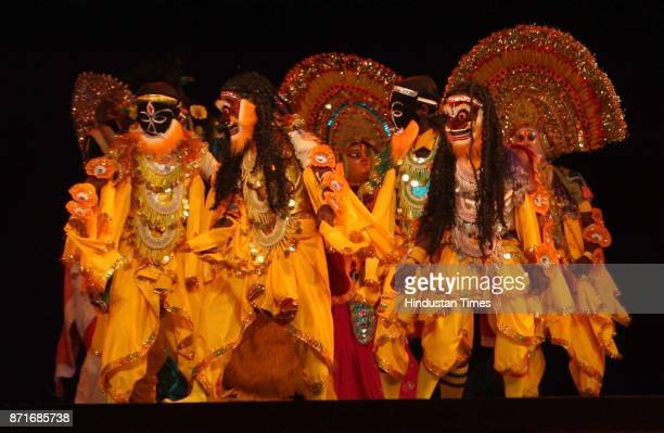 Chau dancers perform during the inaugural function of the 34th National Games at Birsa Munda Athletic stadium in Ranchi