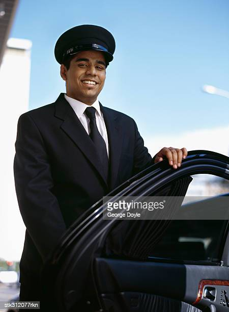 chauffeur opening the door of a car