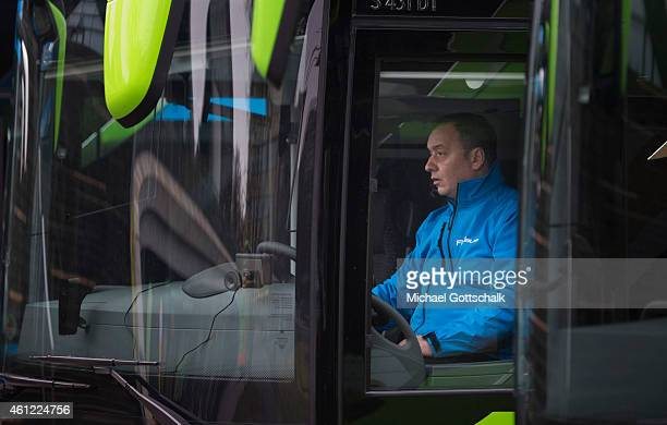 A Chauffeur sits in a coach of german coach company Flixbus Mein Fernbus on January 09 2015 in Berlin Germany The coach company announced its...
