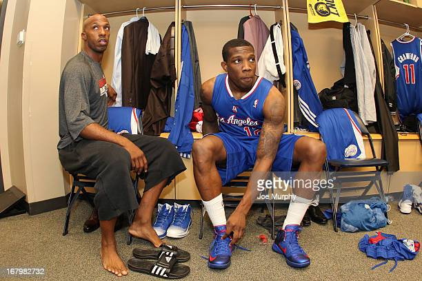 Chauncey Billups and Eric Bledsoe of the Los Angeles Clippers get ready in the locker room before playing the Memphis Grizzlies in Game Six of the...