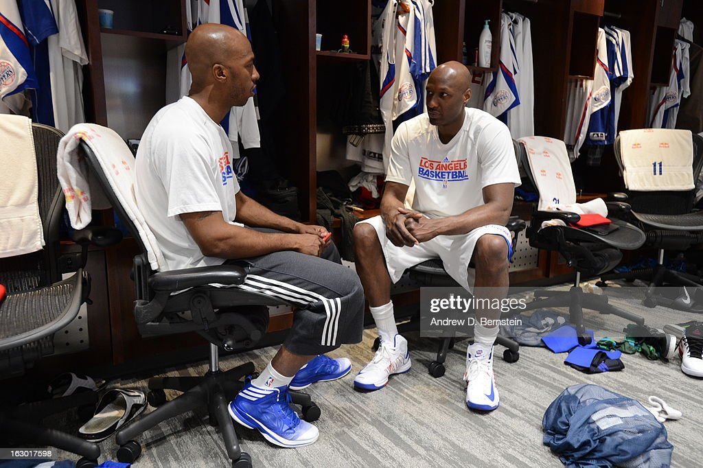 Chauncey Billups #1 and Lamar Odom #7 of the Los Angeles Clippers sit in the locker room before facing the Oklahoma City Thunder at Staples Center on March 3, 2013 in Los Angeles, California.