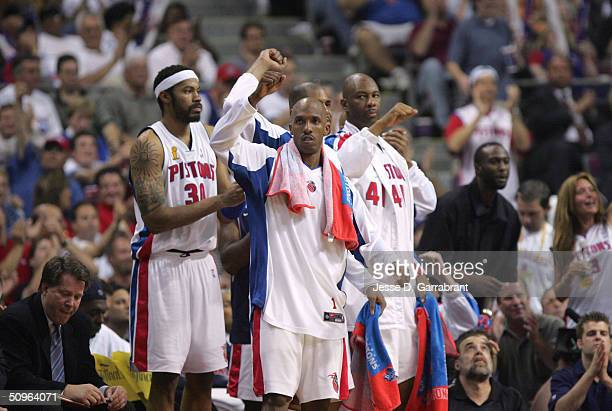 Chauncey Billups and the bench of the Detroit Pistons celebrate against the Los Angeles Lakers in Game five of the 2004 NBA Finals on June 15 2004 at...