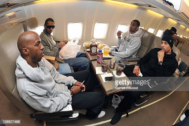 Chauncey Billups Carmelo Anthony Arron Afflalo and Kenyon Martin of the Denver Nuggets eat lunch prior to traveling to Oakland for a game against the...