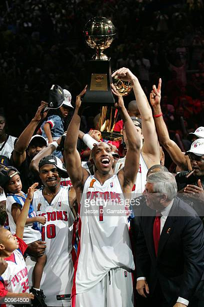 Chauncey Billups of the Detroit Pistons celebrates after winning the Championship as he holds up his Finals MVP Trophy in Game five of the 2004 NBA...