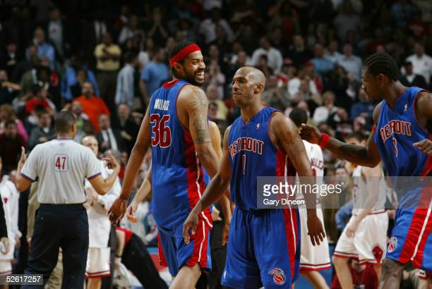 Chauncey Billups of the Detroit Pistons celebrates his game winning shot in overtime with teammate Rasheed Wallace against the Chicago Bulls on April...