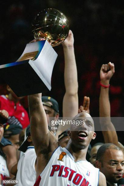 Chauncey Billups of the Detroit Pistons celebrates with the MVP trophy after defeating the Los Angeles Lakers 10087 in game five of the 2004 NBA...