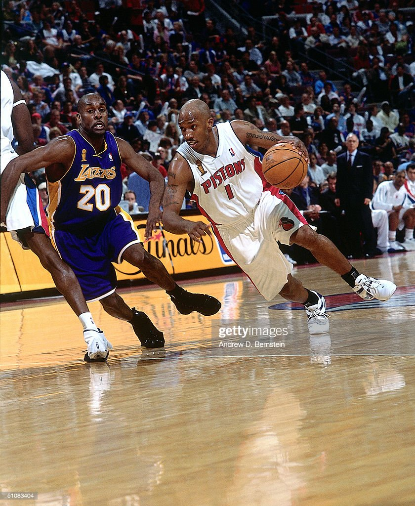 Chauncey Billups #1 of the Detroit Pistons drives the ball past Gary Payton #20 of the Los Angeles Lakers during game three of the 2004 NBA Finals on June 10, 2004 at The Palace of Auburn Hills in Auburn Hills, Michigan.
