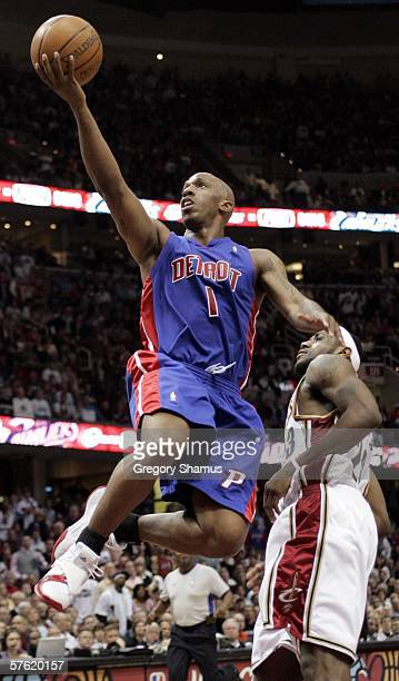 Chauncey Billups of the Detroit Pistons gets to the basket in front of LeBron James of the Cleveland Cavaliers in game four of the Eastern Conference...