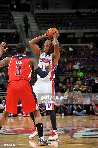Chauncey Billups of the Detroit Pistons looks to pass the ball against Bradley Beal of the Washington Wizards during the game on October 22 2013 at...