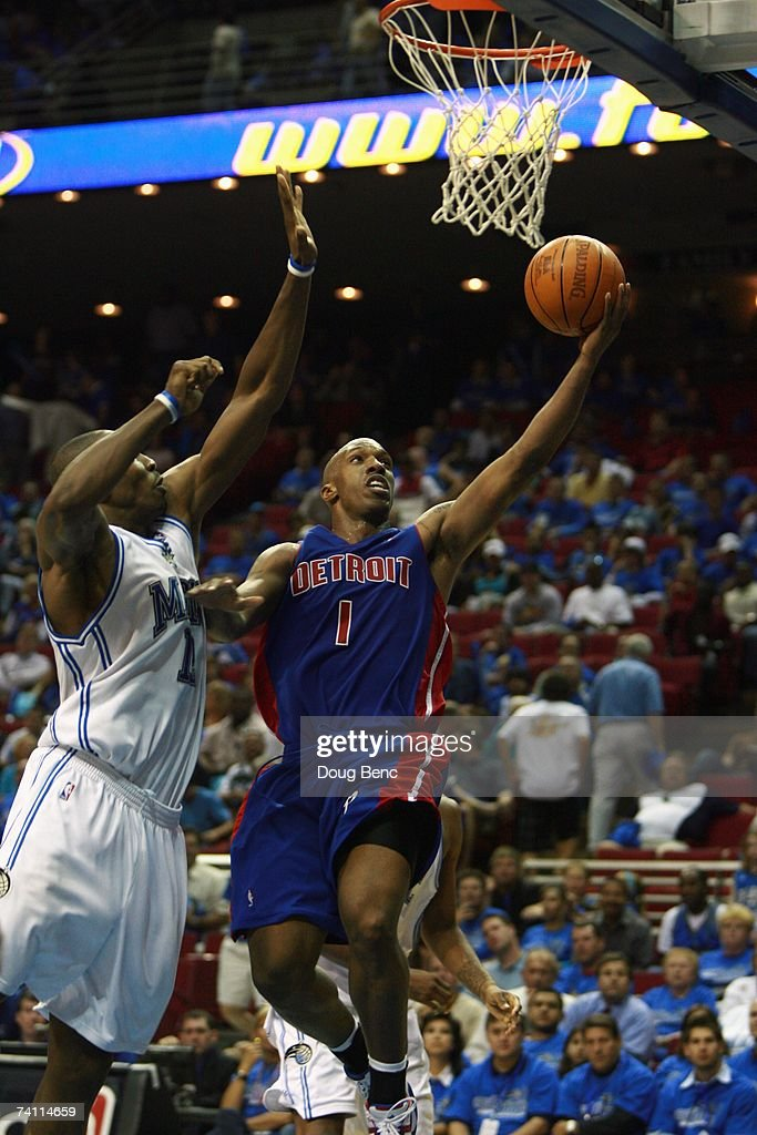 Chauncey Billups #1 of the Detroit Pistons shoots a layup against <a gi-track='captionPersonalityLinkClicked' href=/galleries/search?phrase=Dwight+Howard&family=editorial&specificpeople=201570 ng-click='$event.stopPropagation()'>Dwight Howard</a> #12 of the Orlando Magic in Game Three of the Eastern Conference Quarterfinals during the 2007 NBA Playoffs at Amway Arena on April 26, 2007 in Orlando, Florida. The Pistons won 93-77.