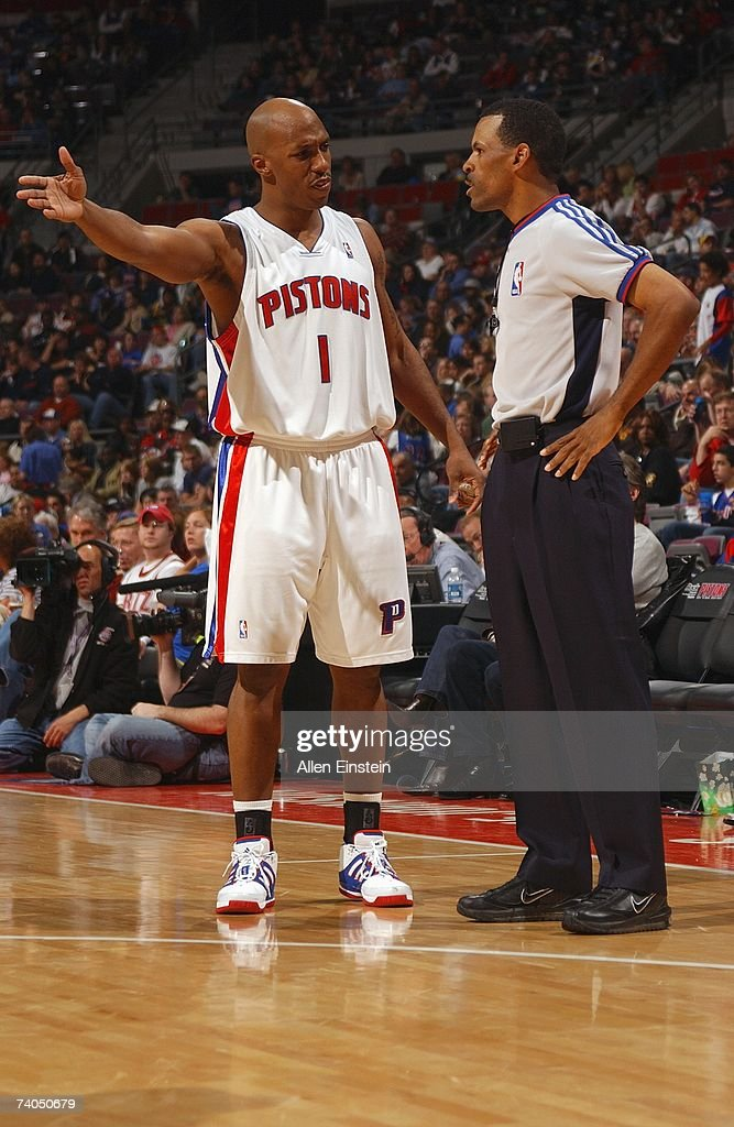 Chauncey Billups of the Detroit Pistons talks to referee Eric Lewis during the game against the Philadelphia 76ers at the Palace of Auburn Hills on...