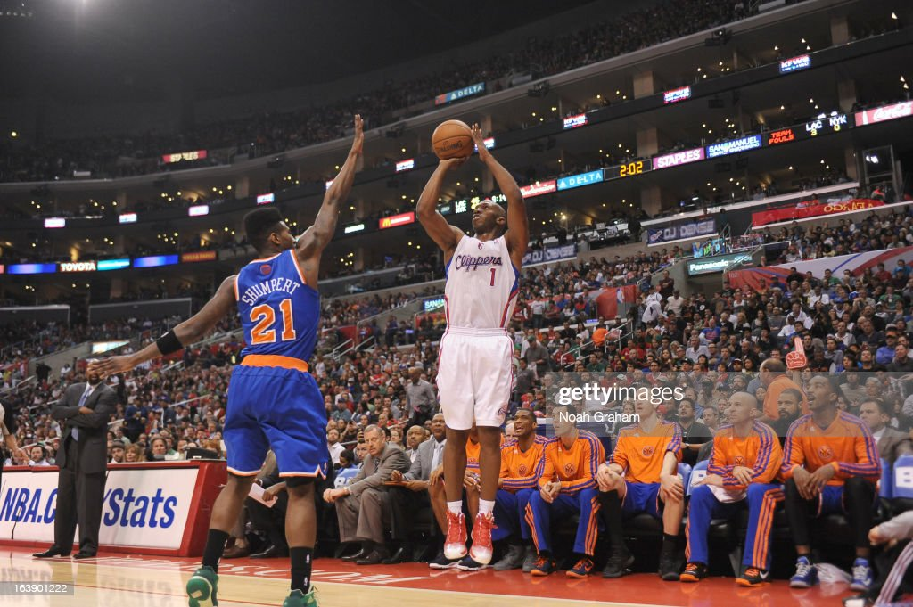 Chauncey Billups #1 of the Los Angeles Clippers goes for a jump shot against Iman Shumpert #21 of the New York Knicks during the game between the Los Angeles Clippers and the New York Knicks at Staples Center on March 17, 2013 in Los Angeles, California.