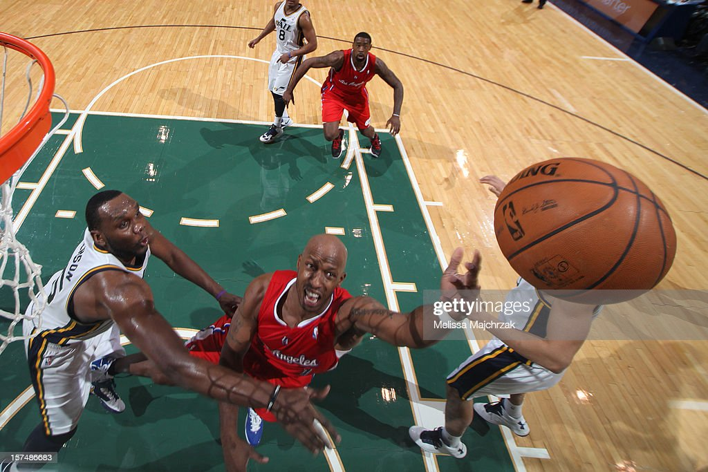 <a gi-track='captionPersonalityLinkClicked' href=/galleries/search?phrase=Chauncey+Billups&family=editorial&specificpeople=201508 ng-click='$event.stopPropagation()'>Chauncey Billups</a> #1 of the Los Angeles Clippers shoots a layup against <a gi-track='captionPersonalityLinkClicked' href=/galleries/search?phrase=Al+Jefferson&family=editorial&specificpeople=201604 ng-click='$event.stopPropagation()'>Al Jefferson</a> #25 of the Utah Jazz at Energy Solutions Arena on December 03, 2012 in Salt Lake City, Utah.