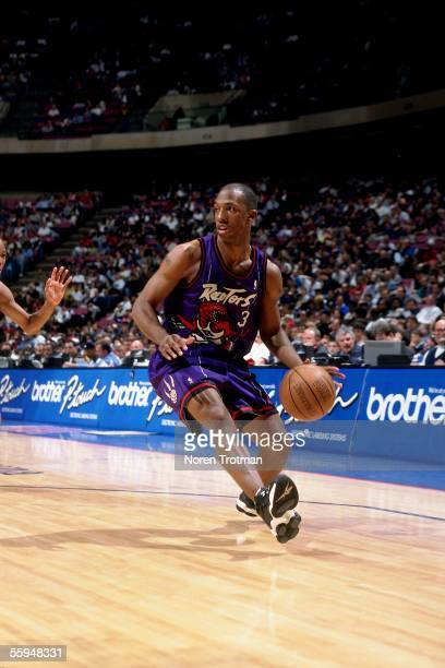 Chauncey Billups of the Toronto Raptors drives to the basket against the New Jersey Nets during an NBA game circa 1998 at Continental Airlines Arena...