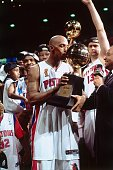 Chauncey Billups#1 of the Detroit Pistons kisses his Most Valuable Player Trophy after Game Five of the 2004 NBA Finals on June 15 2004 at The Palace...