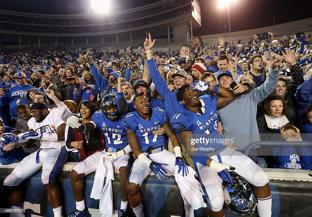 Chauncey Lanier Brayden Scott and Latarius Brady of the Memphis Tigers celebrate winning the AAC after a game against the Connecticut Huskies on...
