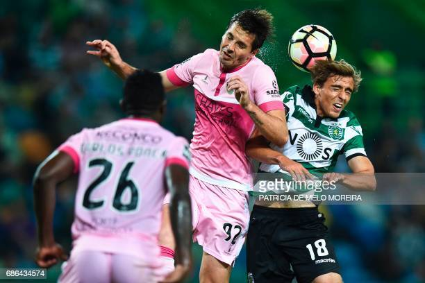 Chaves' Brazilian midfielder Victor Massaia heads the ball with Sporting's midfielder Francisco Geraldes during a press conference in Madrid on May...