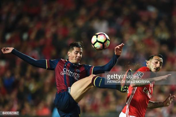 Chaves' Brazilian midfielder Victor Massaia vies with Benfica's Greek forward Konstantinos Mitroglou during the Portuguese league football match SL...