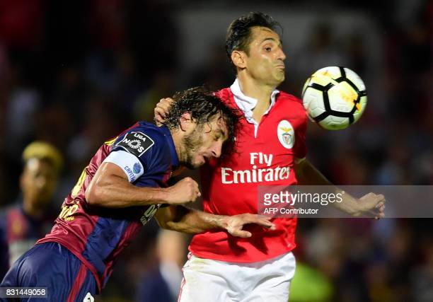 Chaves' defender Nuno Andre Coelho vies with Benfica's Brazilian forward Jonas during the Portuguese league football match between GD Chaves and SL...