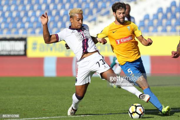 Chaves forward Matheus Pereira from Brazil vies with GD Estoril Praia defender Joel Ferreira from Portugal for the ball possession during the match...