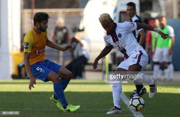 Chaves forward Matheus Pereira from Brazil with GD Estoril Praia defender Joel Ferreira from Portugal in action during the Primeira Liga match...