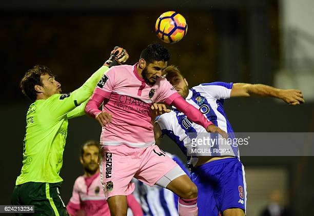 Chaves' goalkeeper Antonio Filipe jumps for the ball with Chaves' Brazilian defender Leandro Freire and Porto's Belgian forward Laurent Depoitre...
