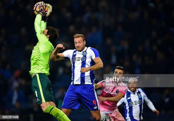 Chaves' goalkeeper Antonio Filipe stops a ball next to Porto's Belgian forward Laurent Depoitre during the Portuguese league football match FC Porto...