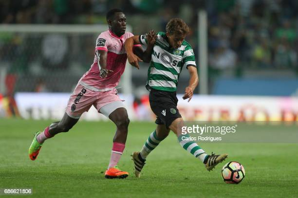 Chaves's forward William Oliveira from Brazil tries to stop Sporting CP's midfielder Francisco Geraldes from Portugal during the Sporting CP v GD...