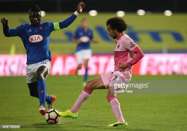 Chaves's midfielder Fabio Martins from Portugal with Belenenses's forward Abel Camara from Portugal in action during the Primeira Liga match between...