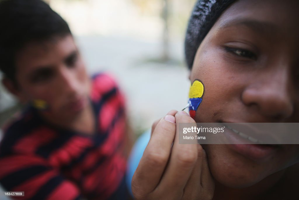 A Chavez supporter has a heart painted in Venezuelan colors on her cheek as others wait in line to view the body of deceased Venezuelan President Hugo Chavez on March 9, 2013 in Caracas, Venezuela. Venezuelans continue to wait in line for hours to pay their last respects to Chavez on the day after his funeral. Venezuela's elections commission has set April 14 as the date for voting to replace the late Chavez.