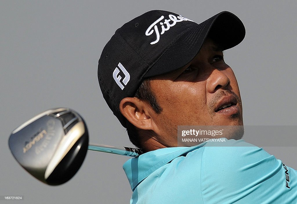 Chawalit Plaphol of Thailand drives the ball out of a bunker on the eighteenth greens during the Avantha Masters golf tournament in Greater Noida, on the outskirts of New Delhi, on March 15, 2013.