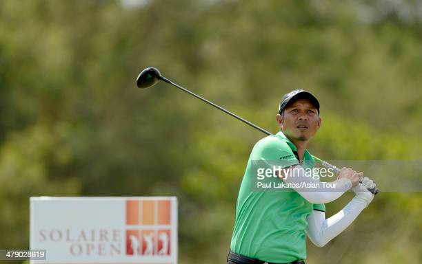 Chawalit Plaphol of Thailand plays a shot during round four of the Solaire Open at The Country Club on March 16 2014 in Manila Philippines