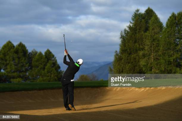 Chawrasia of India plays out of the bunker on the 10th during day one of the 2017 Omega European Masters at CranssurSierre Golf Club on September 7...