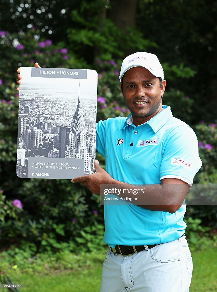 Chawrasia of India poses with the Golfer of the Month award for March during day two of the BMW PGA Championship at Wentworth on May 27, 2016 in Virginia Water, England.