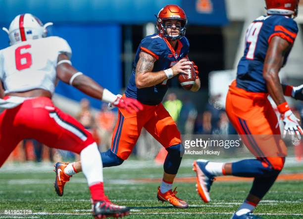Chayce Crouch of the Illinois Fighting Illini looks downfield during the game against the Ball State Cardinals at Memorial Stadium on September 2...